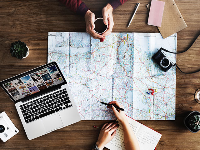 Travel Planning with a map and laptop