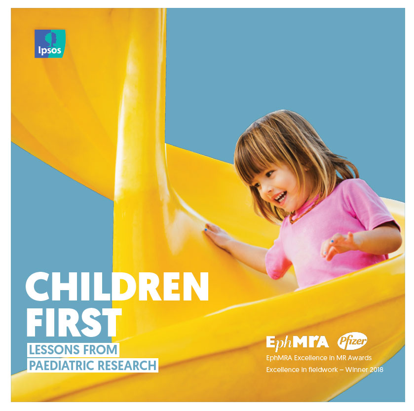 Child sliding down yellow slide - Children First. Lessons from Pediatric Research