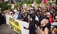 Crowd of protesters holding signs | George Floyd | Ipsos