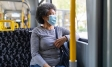 Older woman sitting on a bus, wearing face mask | Covid-19 crisis and unemployment | Ipsos