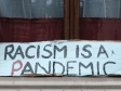 "Sign saying ""Racism is a Pandemic"""