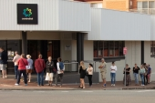 The newly unemployed queue outside their local Centrelink office
