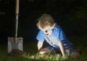 Digging boy finding treasure